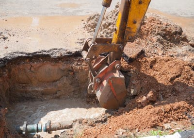Excavator bucket selective focus, bulldozer work a hole the repa